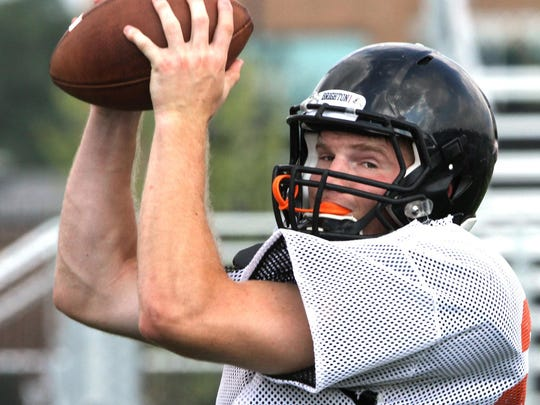 Brighton's Joey Clifford catches a pass during practice