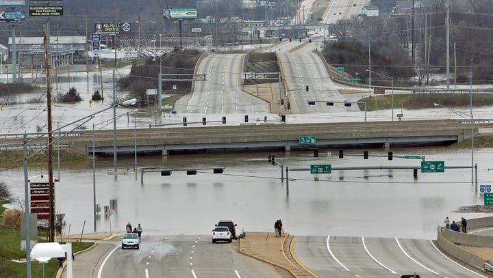 Floodwater from the Meramec River surrounds the bridge