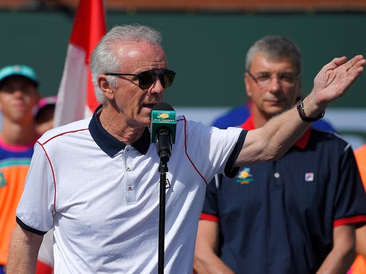"""FILE - In this March 20, 2016, file photo, tournament director Raymond Moore gestures while speaking at the BNP Paribas Open tennis tournament in Indian Wells, Calif.oore, the tournament director of the BNP Paribas Open who said women's pro tennis players """"ride on the coattails of the men,"""" has resigned. (AP Photo/Mark J. Terrill, File)"""