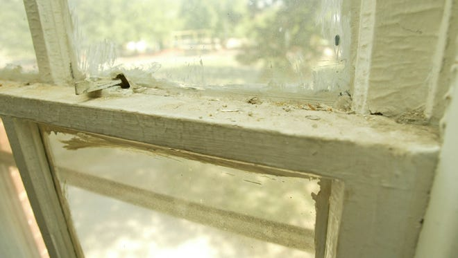 Jamia Handy's daughter, Jaiah Chatman, 20-months-old, built up a toxic blood lead level  from the paint in their rental home in Baltimore, Md., shown here on Sept. 21, 2007. The paint and dust around the windows of the home contained toxic levels of lead.