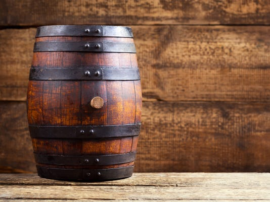 wooden barrel on rustic wooden background