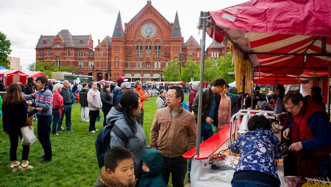 Hundreds attend The 6th Asian Food Fest at Washington Park Saturday, May 14, 2016. More than 20 vendors serve small plates that cost between $2- $6. The Fest will continue on Sunday, May 15 from noon to 8pm.