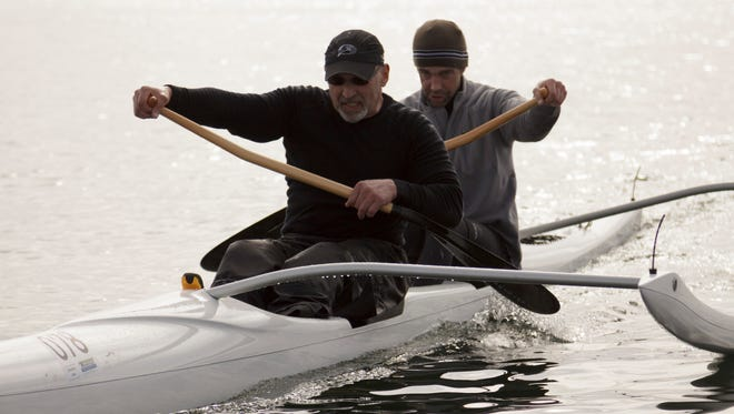 Lance Kahn, front, crosses the finish line in the 2012 Whaling Days outrigger canoe race. Kahn was found unresponsive Tuesday night in Oyster Bay.