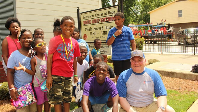 An estimated 2,000 visitors, including Edmundite Missions President Chad McEachern, took part in Friday's Community Festival at the facility. Alvin Benn/Special to the Advertiser
