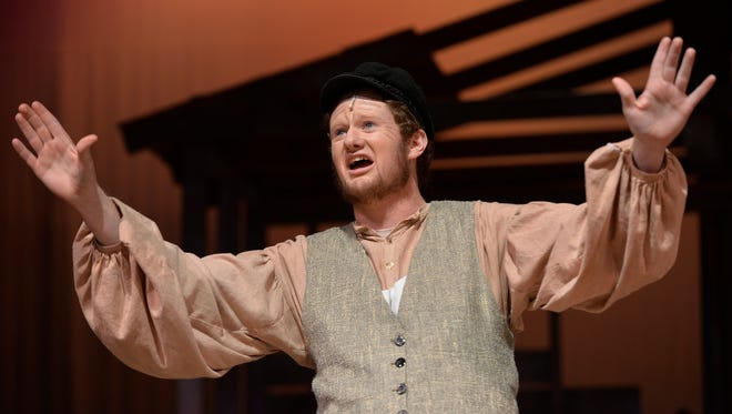 """Patriarch Tevye (Isaac Logeman) sings during a dress rehearsal Wednesday, Nov. 18 for the Apollo High School fall production of """"Fiddler on the Roof,"""" a musical about a traditional Jewish man and his family in early 20th century Russia who clings to his traditions."""