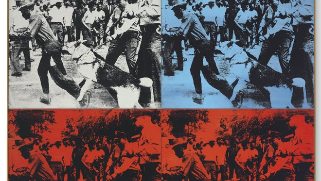 """This undated photo provided by Christie's shows Andy Warhol's 1964 """"Race Riot,"""" in four parts painted with acrylic and silkscreen ink on linen. It is estimated to sell in the region of $50,000,000 when it is auctioned Tuesday, May 13, 2014, at Christie's in New York. (AP Photo/Christie's)"""