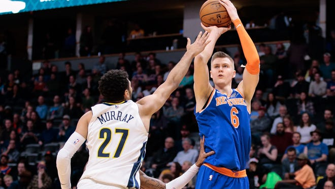 Denver Nuggets guard Jamal Murray (27) defends on a shot from New York Knicks forward Kristaps Porzingis (6) in the fourth quarter at the Pepsi Center.