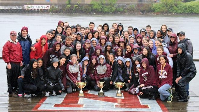 Nutley Raiders crew team celebrating in the rain last weekend.