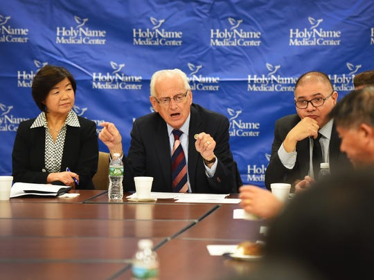Congressman Bill Pascrell speaks as  Kyung Hee Choi