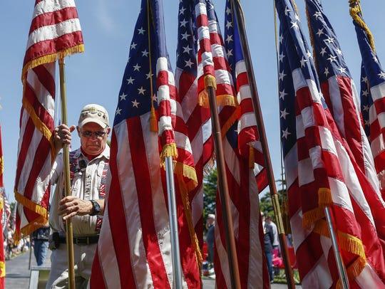 Vietnam veteran Rex Krasche posts the U.S. flag during