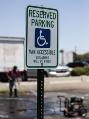 A disabled placard is displayed at the parking lot