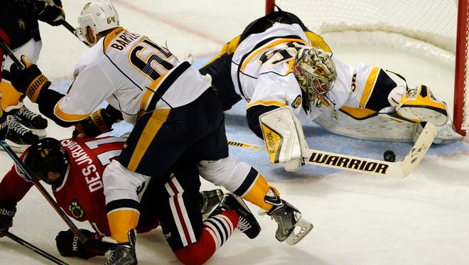 Predators goalie Pekka Rinne makes a save against the Blackhawks during the first overtime period of Game 4.