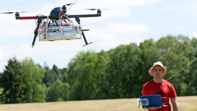 An independent searcher controls a drone during an experimental flight to make searches on the atmosphere, on May 20, 2016, in the Centre of Atmospheric Research in Lannemezan in the French Pyrenees.
