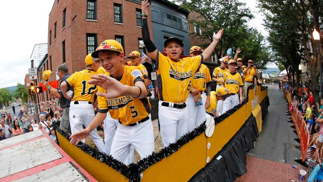 The Regional Champion Little League team from Goodlettsville, Tenn., ride in the Little League Grand Slam Parade in downtown Williamsport, Pa., Wednesday, Aug. 17, 2016. The Little League World Series tournament starts Thursday in South Williamsport, Pa. (AP Photo/Gene J. Puskar).
