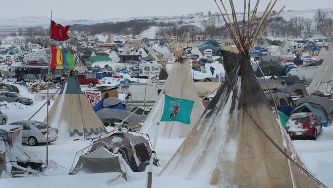 Snow covers Oceti Sakowin Camp near the Standing Rock Sioux Reservation on November 30