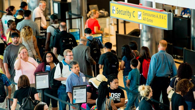 Travelers wait in line at the security checkpoint at Baltimore/Washington International Airport in Baltimore, Md., on June 29, 2017.