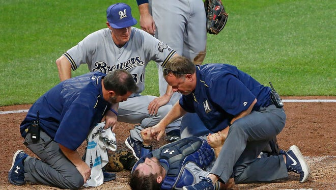 Brewers catcher Stephen Vogt will be out at least a month after getting injured during a collision with Chad Kuhl of the Pirates on Monday night.
