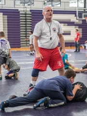 Rob Waller works with kids at Rob Waller's All-American