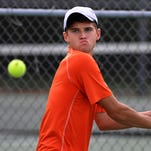 Charlotte's Alex Reinbold keeps his eye on the ball Thursday 10/8/2015  in early action of tennis regionals.