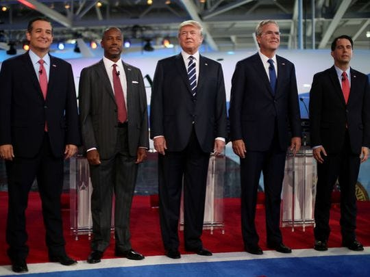 Republican presidential candidates Ted Cruz, Ben Carson, Donald Trump, Jeb Bush and Scott Walker stand onstage during the presidential debate at the Reagan library on Sept. 16, 2015 in Simi Valley, Calif.