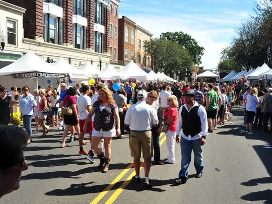 The crowd wanders South Street at the 2014 Morristown