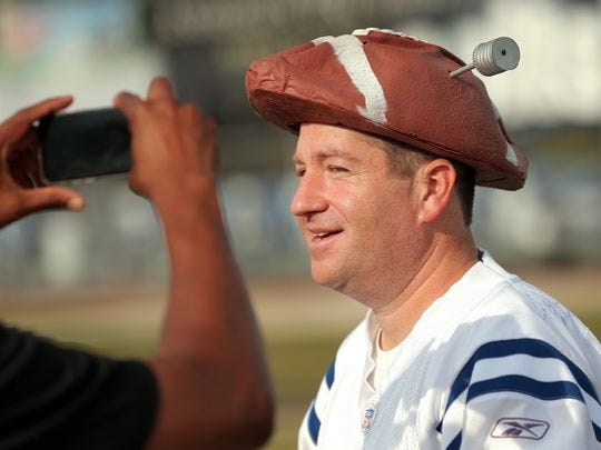 Michael Lieber, an Indy native, poses in one of the hats he sells on his website DeflateGateHats.com.