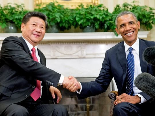 President Obama poses with Chinese President Xi Jinping for a photo during their Sept. 25 meeting in the Oval Office.