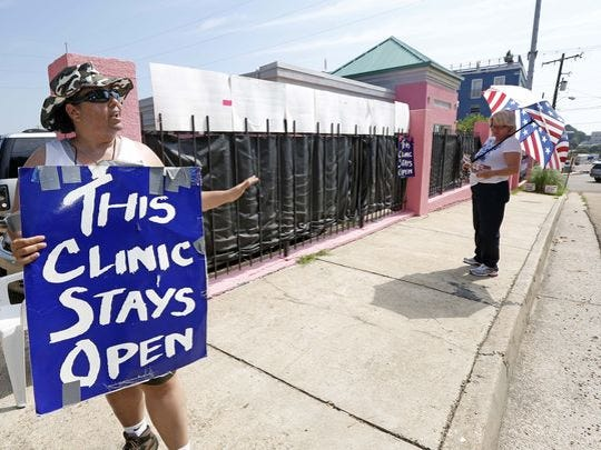 Abortion rights advocates and opponents square off outside Mississippi's lone abortion clinic in 2013.