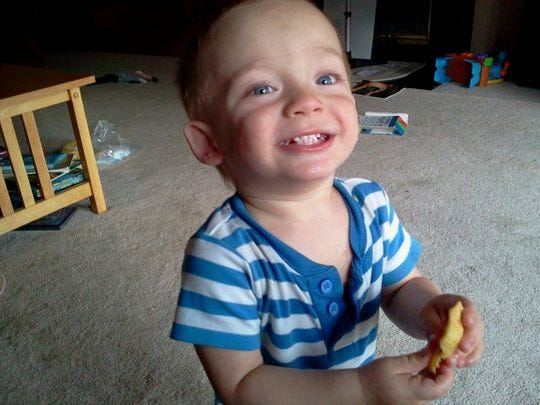 James Nelson, 2, was found dead in his car seat.