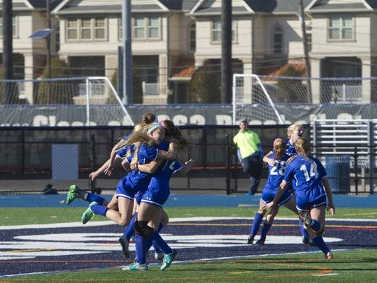 The Blue Devils celebrate after beating Glen Ridge, 2-1, in double overtime of the Group 1 state final on Nov. 21 at Kean University