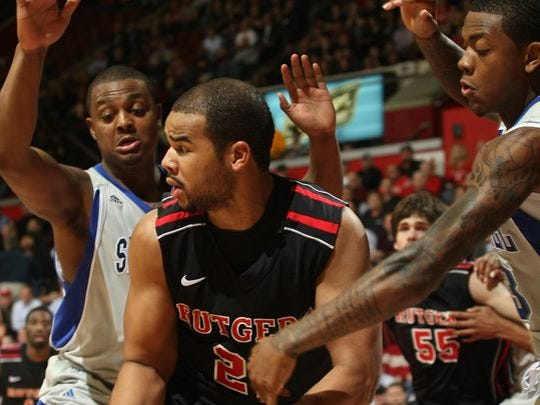 Seton Hall's Herb Pope (left, defending Rutgers' Austin Johnson) was one of the rivalry's instigators.