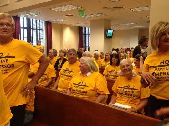 Opponents of a gas compressor station packed into Metro Council chambers July 21 for a public hearing. They supported legislation that would restrict gas compressors to industrial areas.