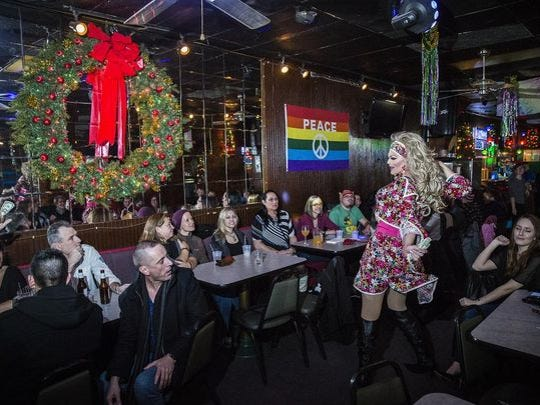 A drag show performer dances during the Mark III Tap Room's open mic night.