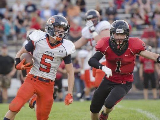 Drake Barnett runs the ball against Bucyrus