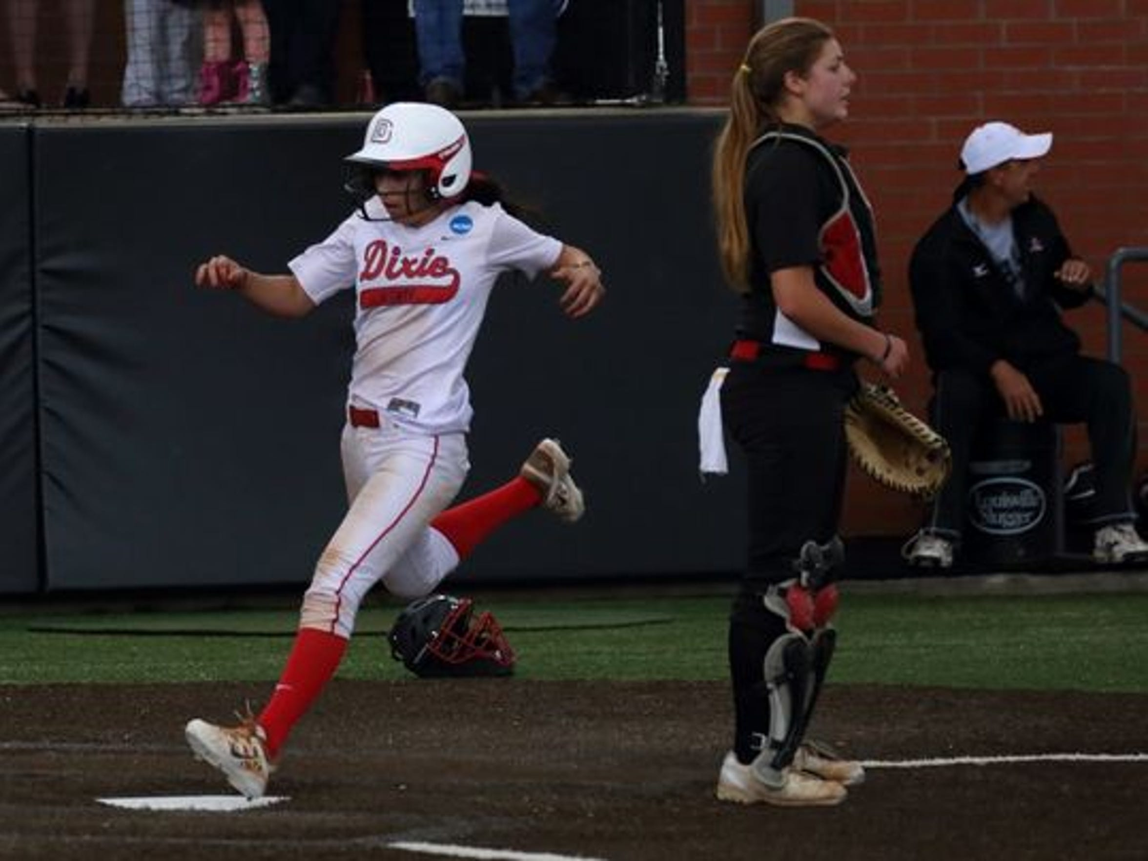 Dixie State's Janessa Bassett scores a run against California Pennsylvania during the semifinals of the NCAA Division II Softball Championship in Edmond, Oklahoma.