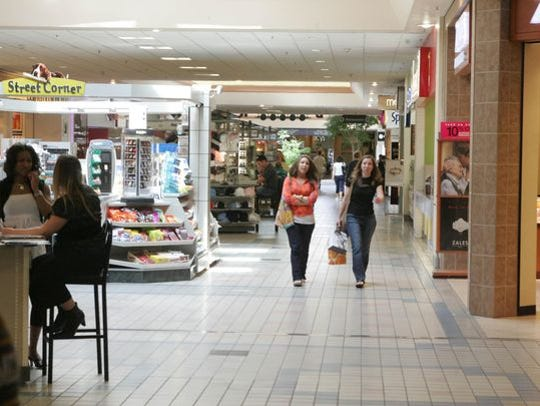 Shoppers walk inside Monmouth Mall in this 2014 file