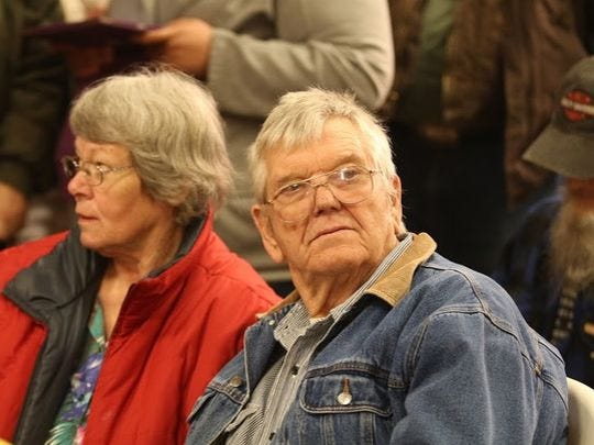 Linda and Jim Ward, parents of Harney County, Ore. Sheriff Dave Ward, attend a community meeting.
