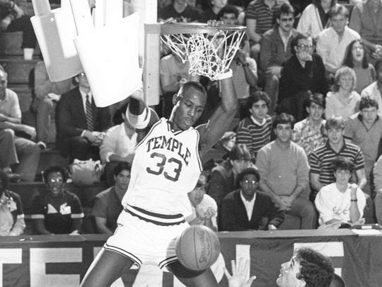 Freehold native Tim Perry finishes a dunk while playing for Temple, before going on to play in the NBA.