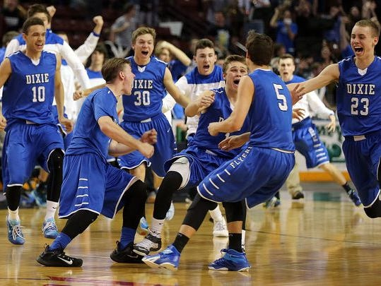 Dixie players celebrate after Tyler Bennett, hit the game winning shot against Bear River during boys 3A high school basketball in West Valley City, Feb, 26, 2015.
