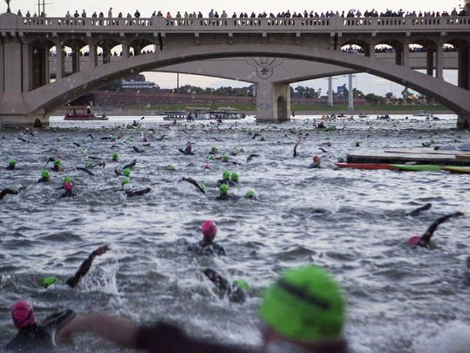 Arizona Ironman competitors begin their race with just