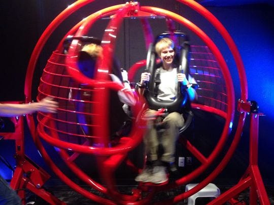 Anna Zanettin, 17, participates in the GyroXtreme ride demonstration at the Tombaugh Theater on Saturday.