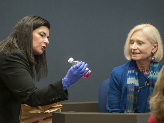 Senior Assistant Prosecutor Mona Armstrong shows a bottle of Benadryl taken as evidence to Paula Holtz Friday; Feb. 26, 2016, in Circuit Judge Michael West's courtroom.