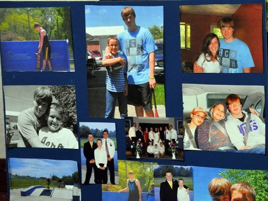 A collection of family pictures of Deven Guilford on a display prepared by his family in October.