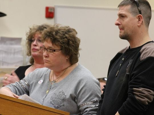 """Julie Looms, middle, told the woman whose illegal U-turn contributed to Loomis' husband's death that """"everything you did that day was reckless and selfish."""" Also pictured is Loomis' sister, Vicki Bessenbacher, and the victim's brother, Brian Loomis."""