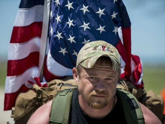 Army veteran Justin Vititoe, former sergeant first class, marches in the Chicago Honor the Fallen Ruck March last May. Approximately 450 military veterans, service members and supporters gathered for a 22-mile ruck march to honor military men and women who suffer from post-traumatic stress disorder or have committed suicide.
