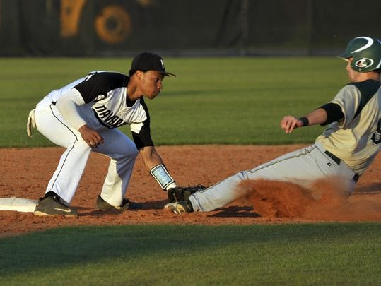 Michael Sandle makes the tag during a playoff game vs. Lincoln last season. Sandle signed Wednesday with South Alabama baseball.