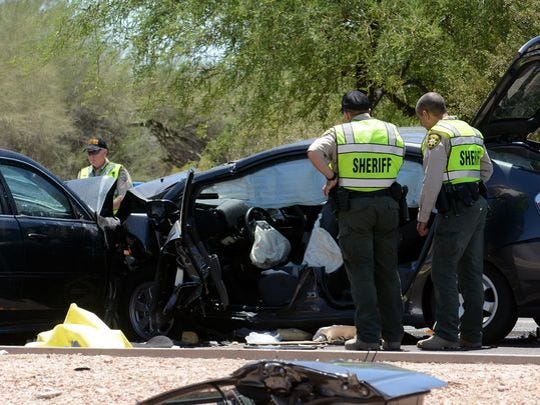 Pima County Sheriff's Department deputies examine a wrecked Toyota Prius at the scene of a fatal car crash on East Ina Road west of Westward Look Drive, north of Tucson, on Saturday, May 7, 2016. Ann Day, the sister of former U.S. Supreme Court Justice Sandra Day O'Connor, died in the crash.