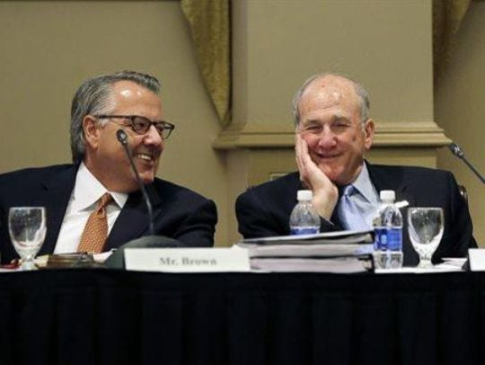 Rutgers Board of Governors chair Greg Brown, left next