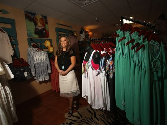 Brittany Cox, the owner of Rustic Diva's, poses for