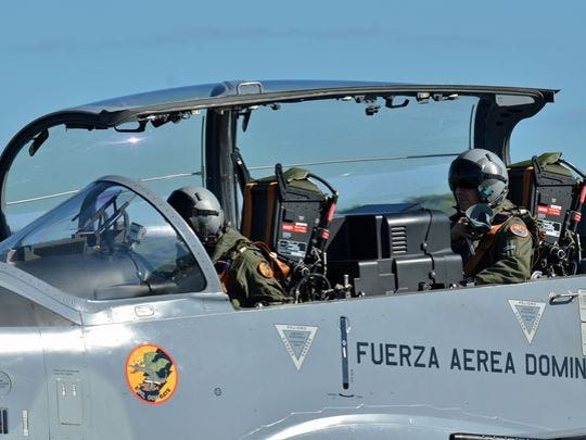 Lt. Col. Eric Perlman, a U.S. Air Force F-16 instructor pilot, prepares to ride in the back seat of a Dominican Republic air force A-29 Super Tucano as part of an exercise to combat illegal drug trafficking in 2013. Training Latin American air forces remains an important part of the U.S. Air Force's counternarcotics mission.